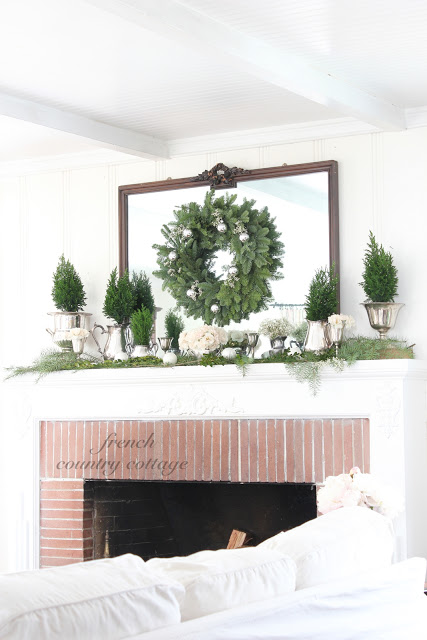 Christmas mantel - love the mini trees (take the house tour)