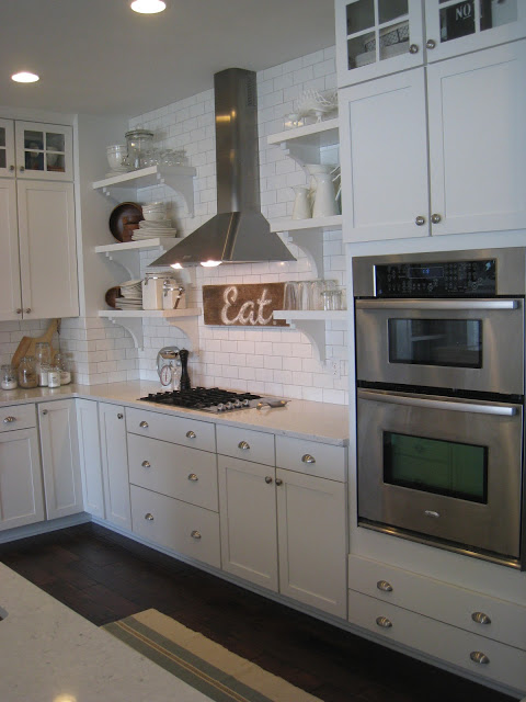Gorgeous white #kitchen - part of this lake house home kellyelko.com