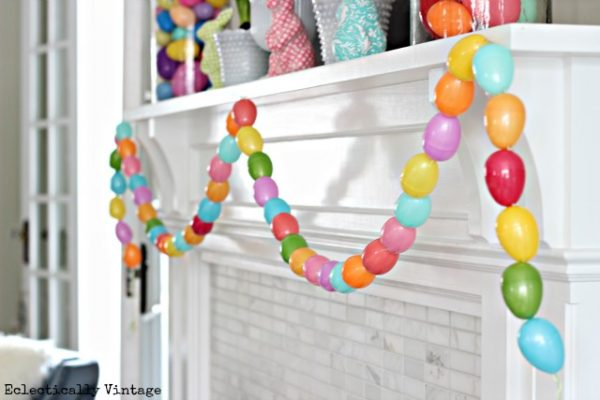 Fun spring mantel with the cutest DIY egg garland! eclecticallyvitnage.com #spring #springcrafts #easter #eastercrafts #kidscrafts #crafting #crafts #diyideas #diyprojects #springmantel #springdecor