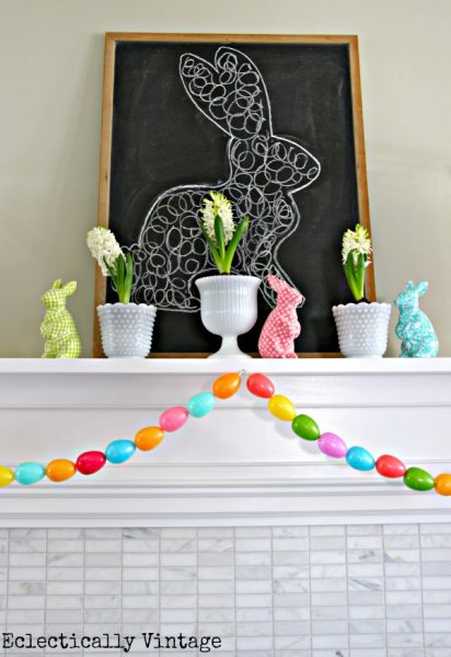Make an Easter egg garland - what a fun spring mantel! kellyelko.com