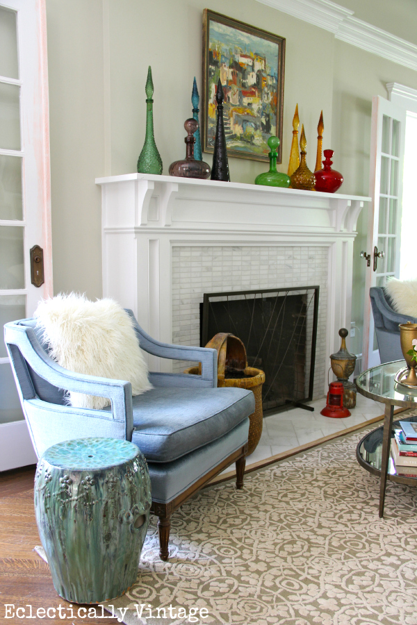 Eclectic living room - love that vintage landscape gallery wall