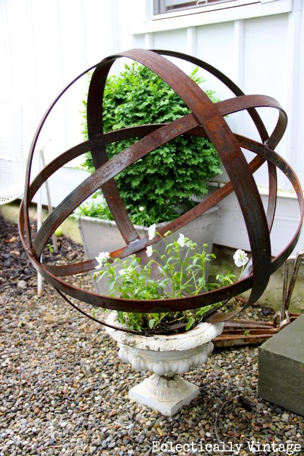 Stunning garden - love the orb in the urn kellyelko.com
