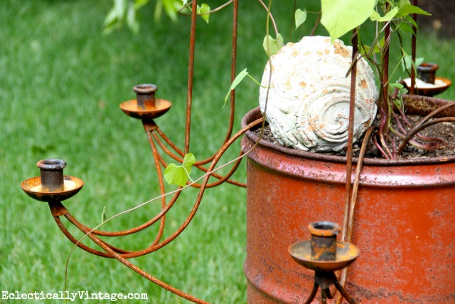 Get creative - giant candle holder as garden trellis.  One of many unique planters at kellyelko.com