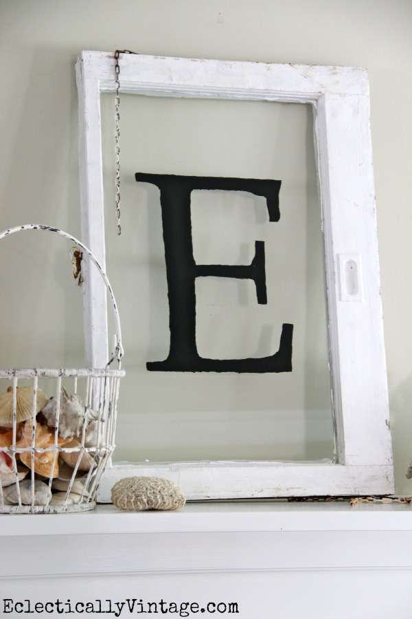 DIY Monogram Antique Window - simple way to make your own monogram on any piece of glass.  kellyelko.com