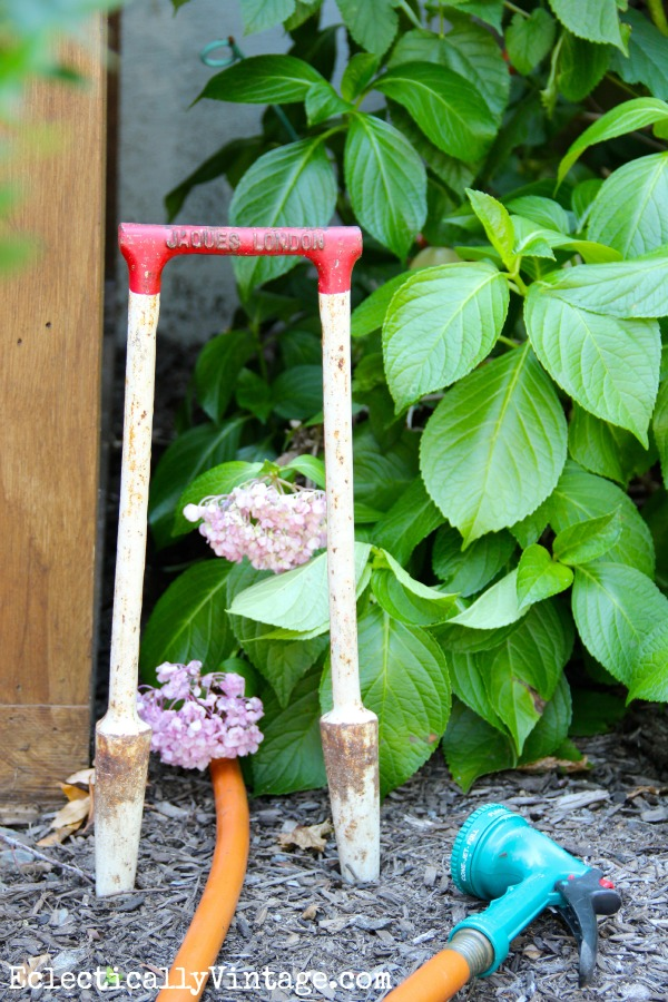 Vintage croquet set wicket - used as a hose guide!  You have to see how she used the rest of the set in her house!  eclecticallyvintage.com