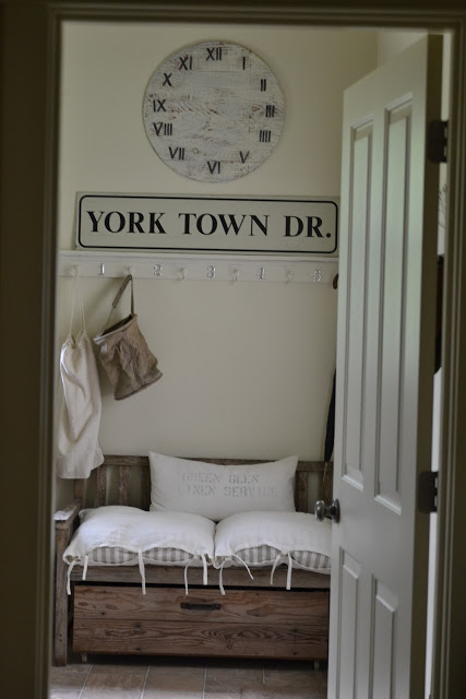 Beautiful mudroom - love the clock