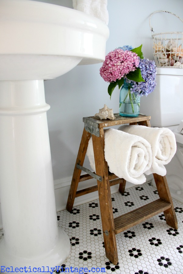 Cute towel storage in this fabulous bathroom!  eclecticallyvintage.com