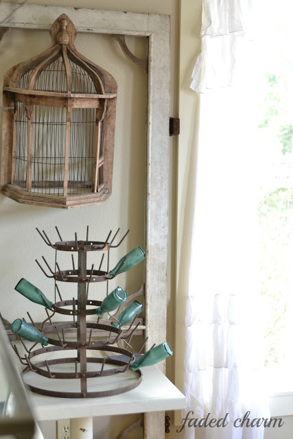 Antique bottle drying rack in this cottage dining room