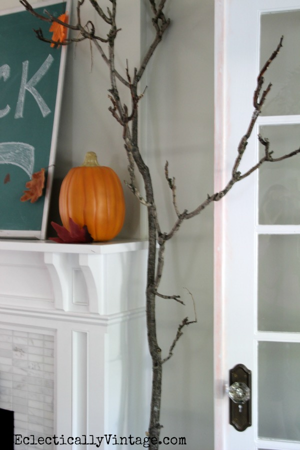 Bring a branch inside for fall - love this house tour!  eclecticallyvintage.com