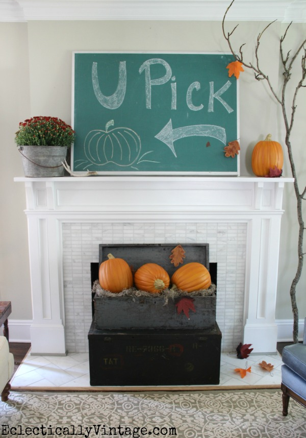 Fall mantel decor - love the giant chalkboard, pumpkins and huge branch kellyelko.com