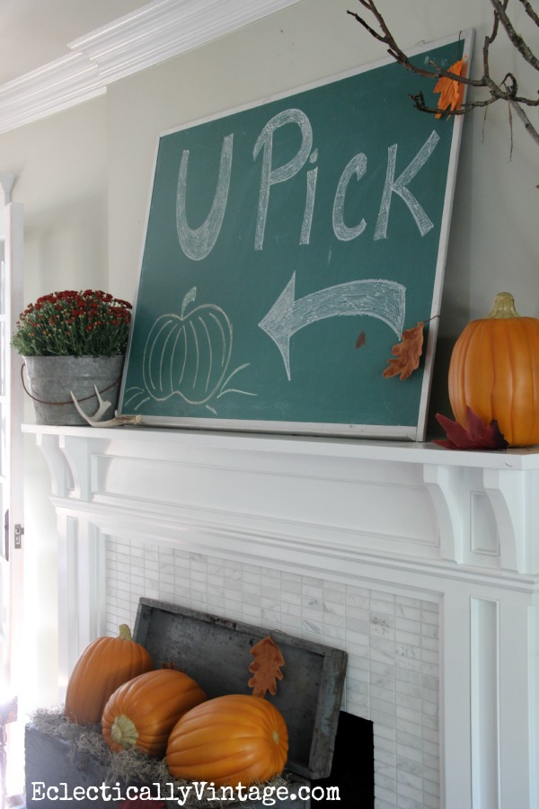 Love the chalkboard on this fun Fall mantel at eclecticallyvintage.com