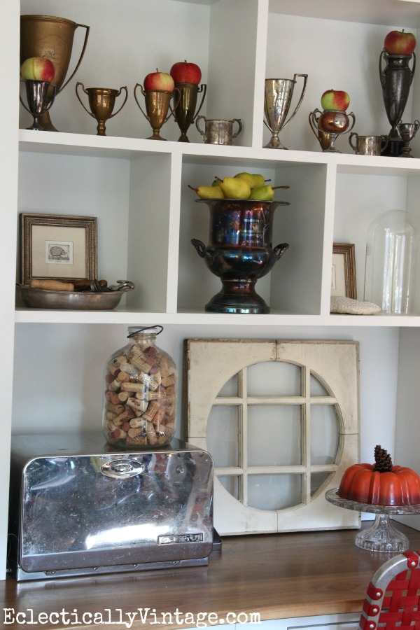 Beautiful shelf arrangement - love the collection of loving cups.  kellyelko.com