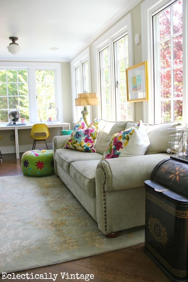 Colorful sunroom - learn tips and tricks to mix colors the right way.  eclecticallyvintage.com