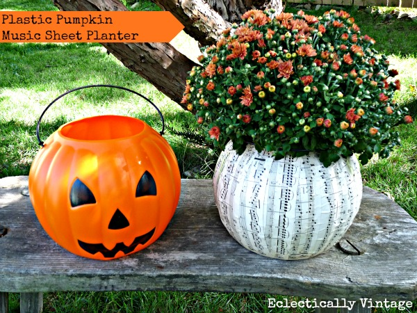 10 Off the Vine Pumpkin Crafts - including this plastic pumpkin turned music sheet planter!  kellyelko.com