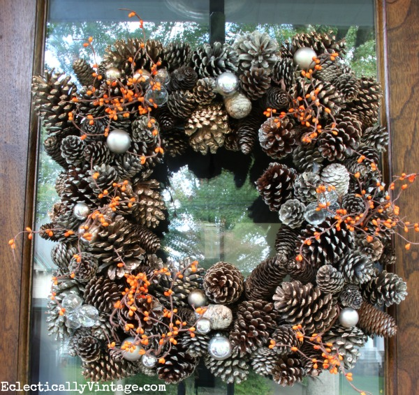 Pinecone wreath jazzed up with berry garland for fall kellyelko.com