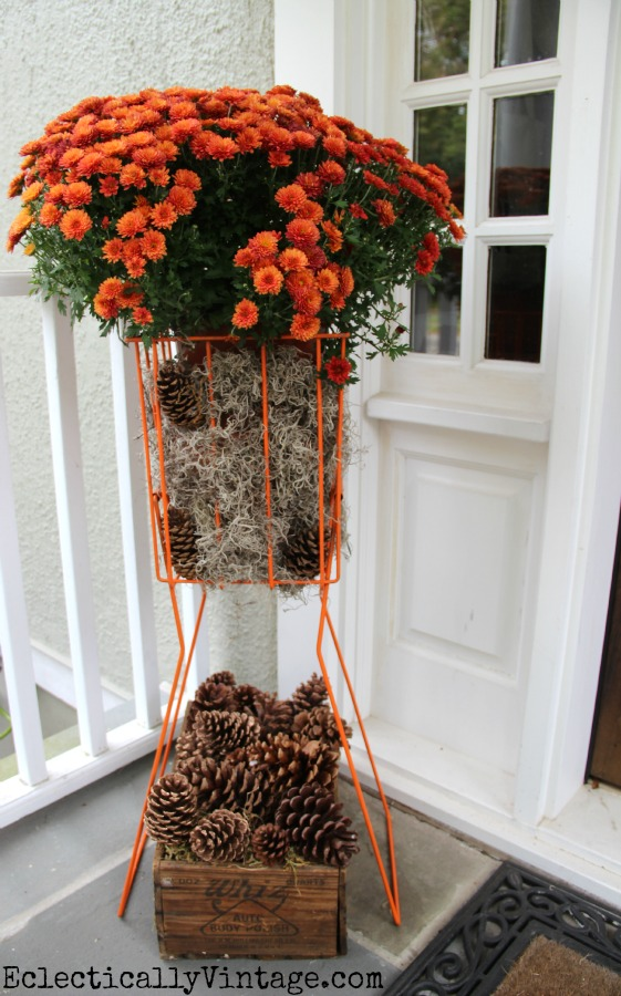 Fabulous idea - a tennis ball hopper #planter!  See more of this #fall porch kellyelko.com