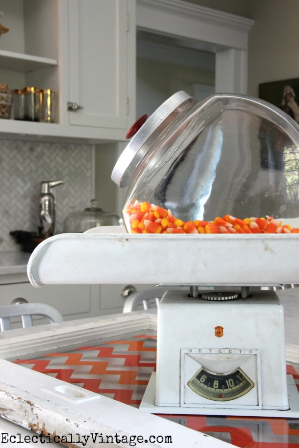 Vintage candy jar on an old scale - love this kitchen!  eclecticallyvintage.com