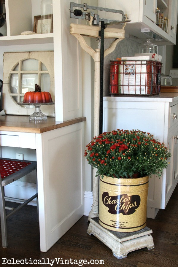 Vintage Doctor Scale - love it as a plant stand in this gorgeous kitchen!  eclecticallyvintage.com