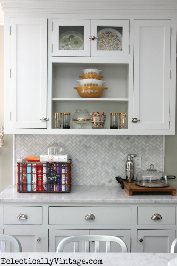 White kitchen - love the open shelves and the fun collections.  eclecticallyvintage.com