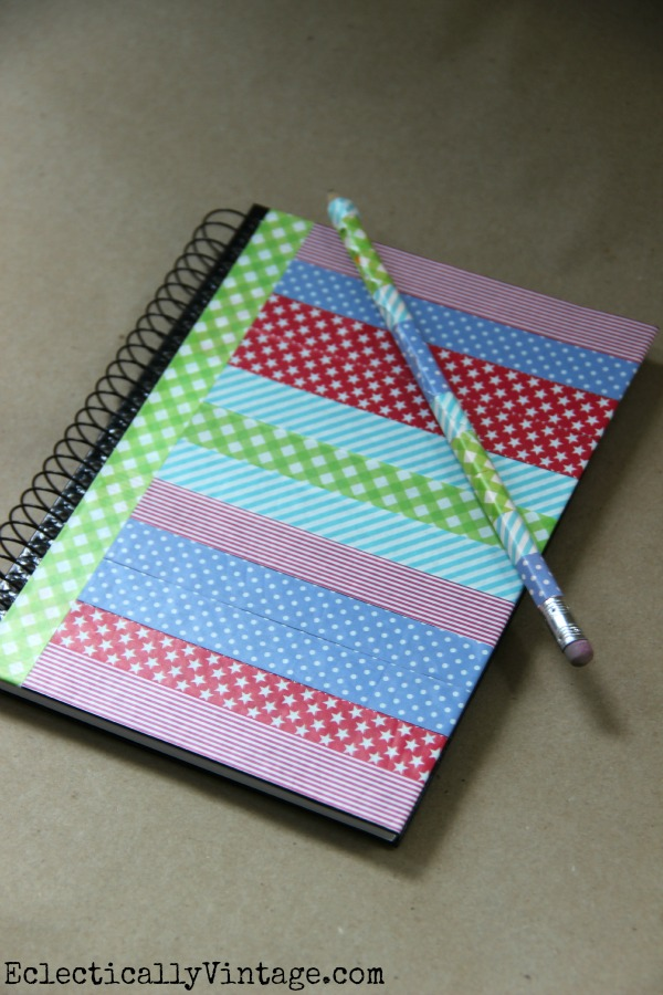 Washi Tape is perfect for dressing up boring notebooks!  One of 5 fun decorative tape ideas at kellyelko.com