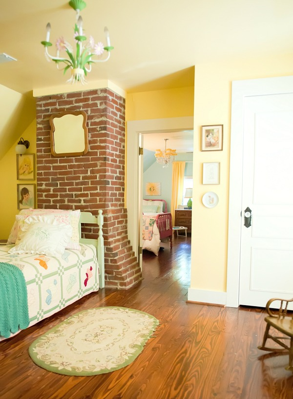 Vintage girls bedroom - love the exposed brick