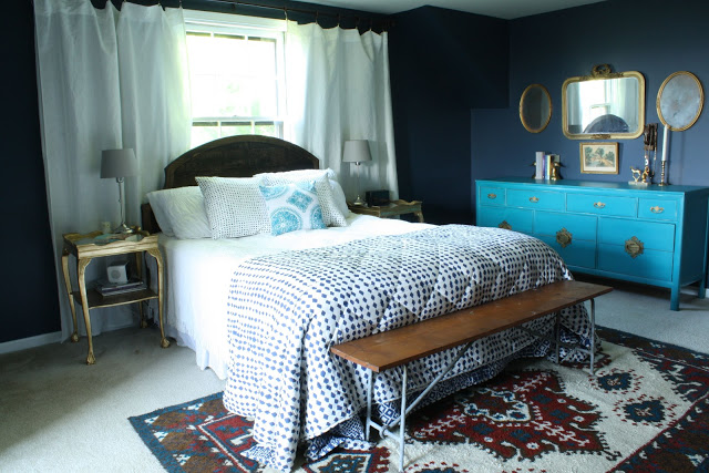 Dramatic master bedroom - love the bold color