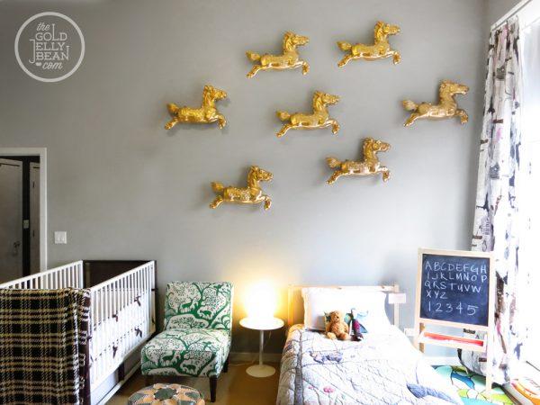 What a fun wall treatment - 3d golden ponies!  kellyelko.com