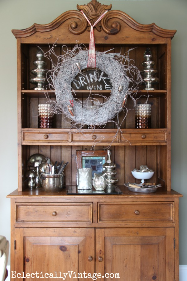 Christmas hutch decorations - love the wreath & mercury glass! kellyelko.com