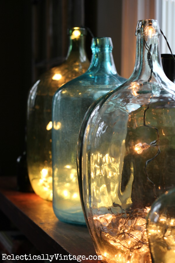 Demijohn bottles filled with string lights for Christmas kellyelko.com