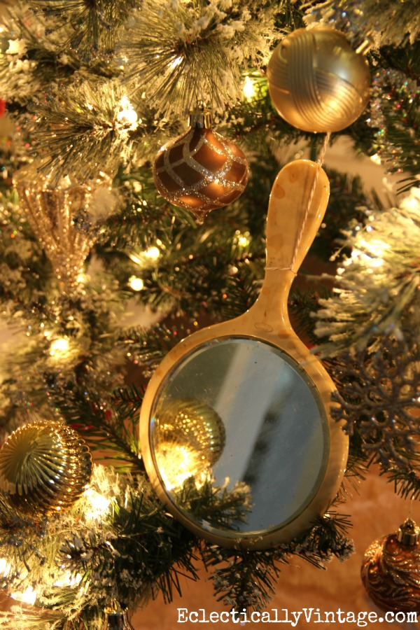 Love the vintage hand mirror ornaments on this metallic tree kellyelko.com