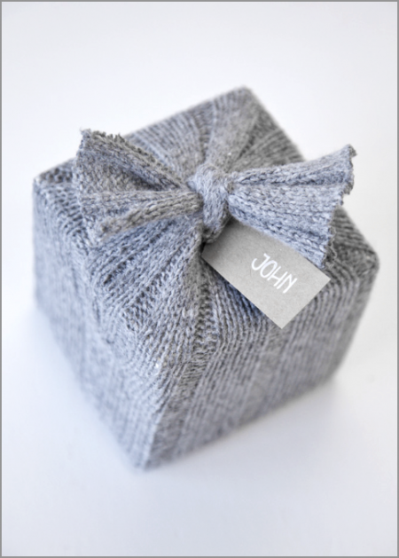 Sweater gift wrap tied with a bow