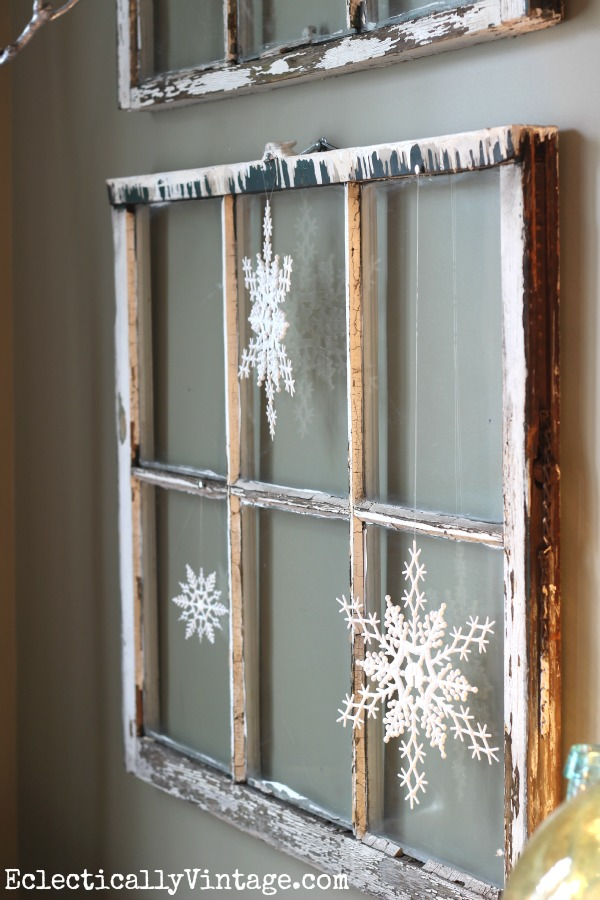 Vintage window with snowflakes - see the wintry white dining room at kellyelko.com