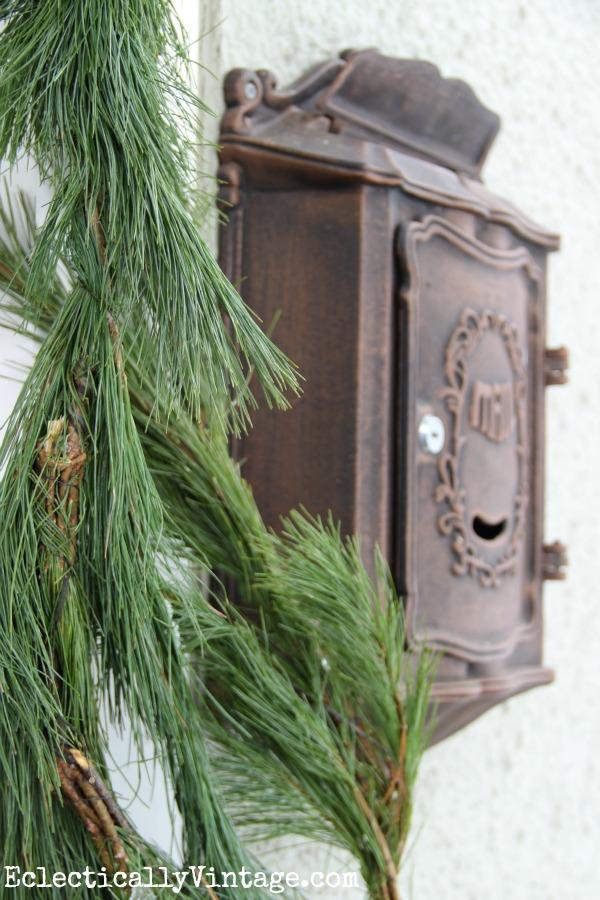 Christmas porch - love the fresh garland kellyelko.com