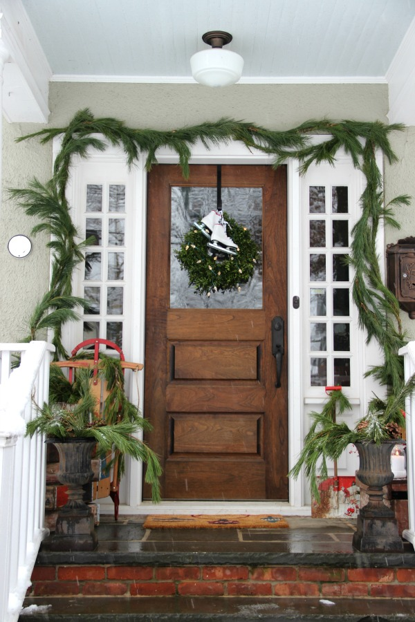 Vintage filled Christmas porch - love all the vintage finds and that door!  kellyelko.com