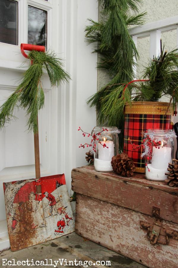 What a fun winter porch - love that cute vintage shovel eclecticallyvintage.com