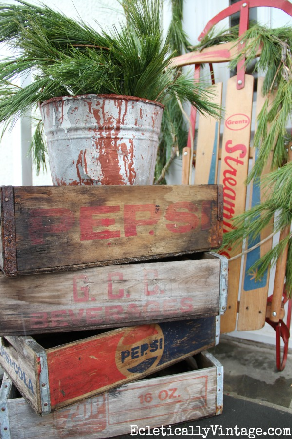 Vintage Pepsi crates on this beautiful winter porch kellyelko.com
