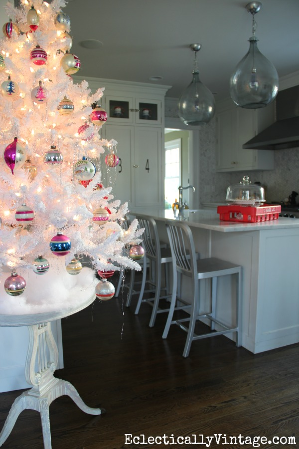 Flocked white Christmas tree in this fun kitchen eclecticallyvintage.com