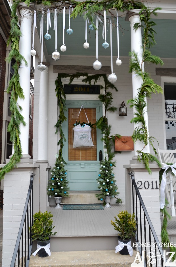 Christmas porch decorating ideas - love the hanging ornaments