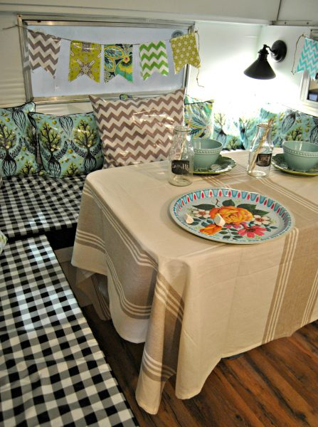 Oilcloth pillows and buntings - such a fun retro look!