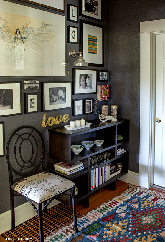 Gallery Wall - love the sentimental objects and dramatic wall color
