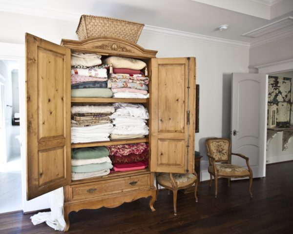 Armoire turned linen closet