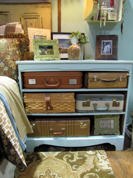 Dresser with vintage suitcase storage