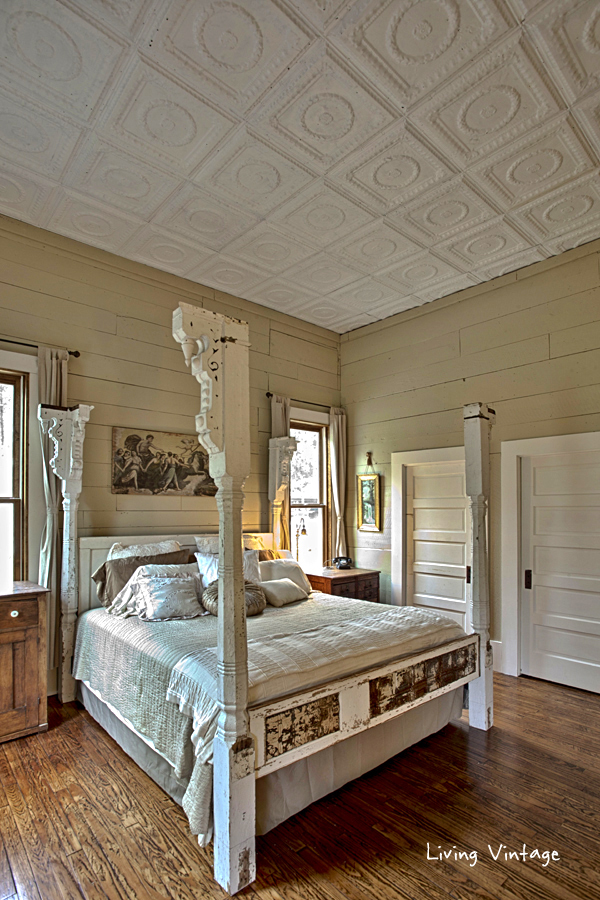 They made this bed from old porch columns and doors!