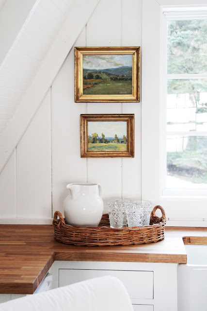 Love vintage paintings hung in the kitchen kellyelko.com