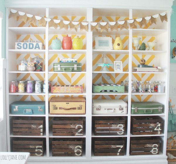Love the vintage suitcase & crate storage in this craft room