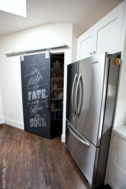 What a fun chalkboard rolling barn pantry door