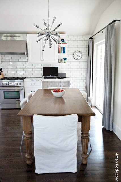 Love the subway wall of tile in this gorgeous kitchen