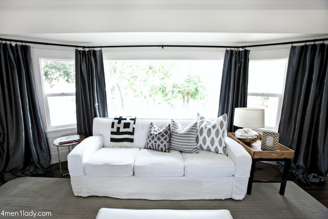 Love the white sofa against the dark drapes
