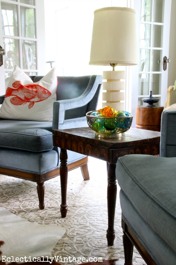 Mid century club chairs in this gorgeous living room eclecticallyvintage.com