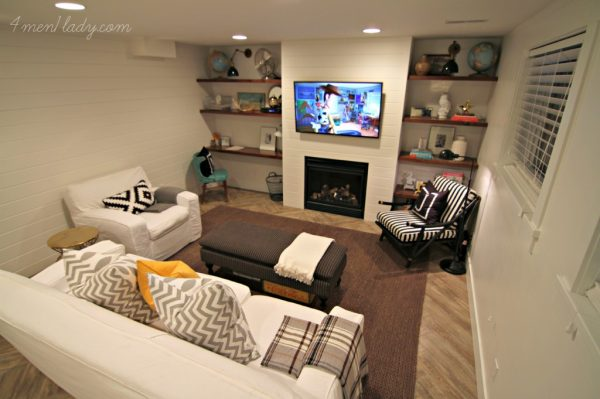 Beautiful basement renovation - love the shelves and plank wall